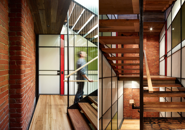 Natural light cascades down the stair atrium, deep into the building. The stair structure was kept as thin as possible to maximise daylight penetration to the lower levels and via the glazed atrium walls. Photo: Peter Bennets The coloured glass panels create further interest. 