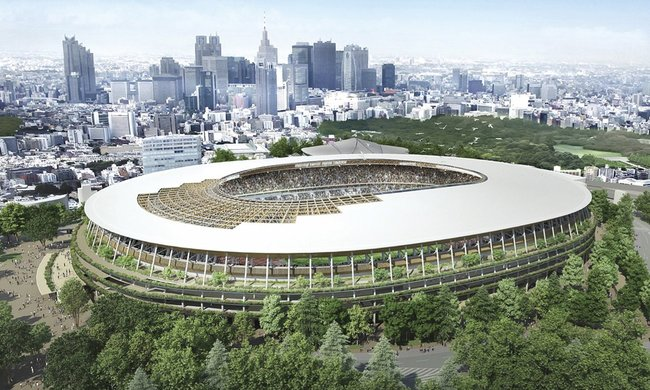 If the wrath of the Japanese architecture establishment doesn't sink Kengo Kuma's Olympic Stadium design, like it did with a certain previous proposal, this structure will be completed by November 2019. (Image via theguardian.com)
