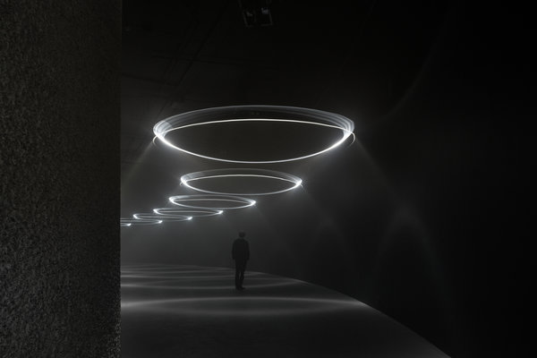 """Momentum,"" a light and sound show at The Curve, an art space at the Barbican Center in London. Galleries are creating unconventional spaces to showcase unusual exhibits. (NYT; Photo: James Medcraft/Barbican)"
