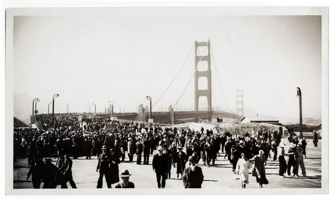 In 1933, the Standard Oil Company sent employee Ted Huggins to photograph the bridge's construction. Huggins visited the site weekly for three years and produced hundreds of photographs, which he offered to news outlets covering the project. Huggins took this picture on the bridge's opening day on...