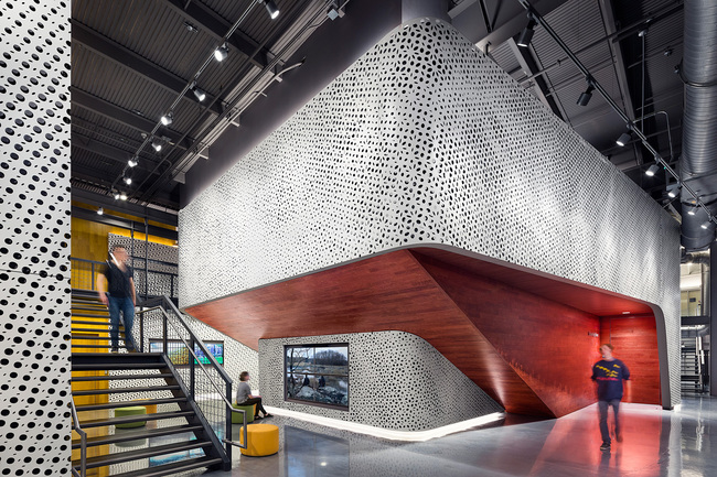 Pratt Institute's Film/Video Department Building features interior spaces that are wrapped in a perforated metal-panel structure created by Pratt Institute School of Architecture alumnus and faculty member Haresh Lalvani. The work is titled Origins (2014). Photo credit: Alexander Severin...