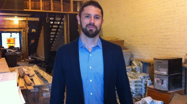 Fundrise co-founder Ben Miller in the partially crowdfunded property at 1351 H St. (Kate Davidson/Marketplace)