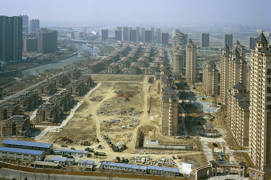 The Bayuquan cityscape in Yingkou is filled with housing projects, most of them empty or unfinished. (Tim Franco for The Wall Street Journal)