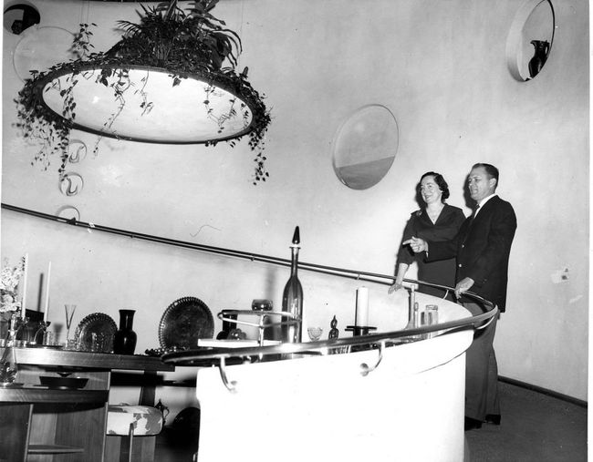 "The V.C. Morris gallery as it appeared in 1960 when Allan Adler — described by The Chronicle as a ""famed silversmith"" — purchased the shop from the estate of the owners who hired truly famed architect Frank Lloyd Wright to transform the space in the late 1940s. Adler is on the right. (Berge Studio) Image via sfchronicle.com."