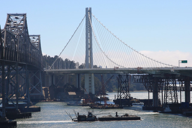 A view of the suspension-bridge section of the East Span of the San Francisco-Oakland Bay Bridge. A replacement for the 1936 original bridge (left in photo), it was designed by a joint venture of T.Y. Lin International and Moffatt & Nicholls Engineers. It will open Sept. 3. Photographer: James S...