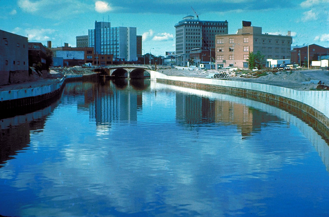 The Flint River running through Flint in the 1970s. Credit: Wikipedia.