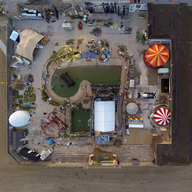 "Aerial view of ""Dismaland,"" the rumored Banksy pop-up show in the British seaside resort of Weston-Super-Mare. Photo: Iain Brimecome & Jon Goff, image via streetartnews.net."