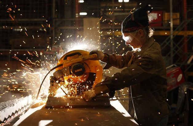 Karen Cusolito, founder of American Steel Studios in Oakland, cuts raw steel for her latest sculpture. Photo: Mike Kepka, The Chronicle