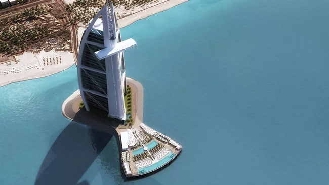 One of the tallest hotels in the world, the Burj Al Arab Jumeirah became an early icon for Dubai's 'anything goe$' mentality. (Image: Jumeirah Grou, via globalconstructionreview.com)