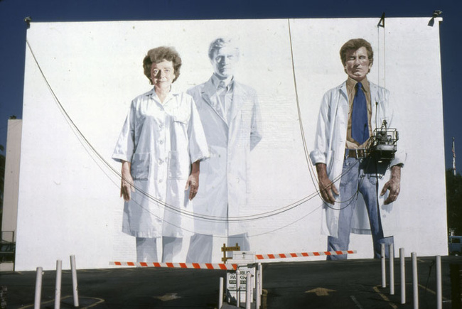 "Muralist Kent Twitchell working on ""Holy Trinity with the Virgin"" on Wilshire Blvd in 1978. (Anne Laskey/Courtesy LA Public Library)"