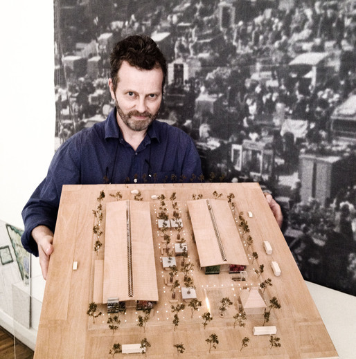Architect Hans Peter Hagens with a model of Torvehallerne. Photo by Chris DeHenzel.