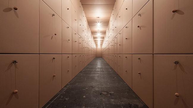 318 prepared dc-motors, cork balls, cardboard boxes 100x100x100cm by Zimoun