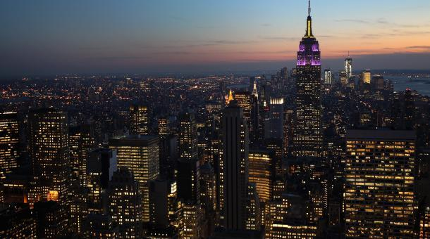 The Empire State Building towers over the Manhattan skyline in New York City. The owners of the Empire State Building have registered to sell shares to the public. (Image: John Moore/Getty Images via marketplace.org)