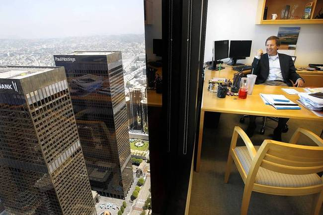 Greg Koltun, managing partner of Morrison & Foerster in L.A., looks out from his office near the top of the Aon Center. The building is the second-tallest in downtown. (Christina House / For the Times)