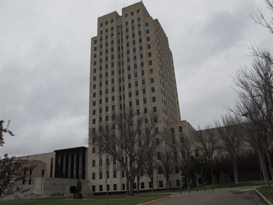 (Dale Wetzel/ Associated Press ) - This photo, taken Thursday, April 19, 2012, shows the North Dakota Capitol, whose main tower is almost 250 feet high. The Republican majority leader of the Minnesota House on Thursday described the North Dakota Capitol building, which is located in Bismarck...