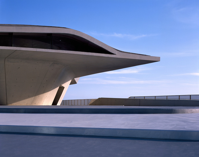 Italy has a larger-than-average collection of Zaha Hadid-designed buildings, including the MAXXI in Rome and the newly-opened Maritime Station in Salerno (pictured above). She also showed extensively at past iterations of the Venice Biennale. Image credit: Helene Binet