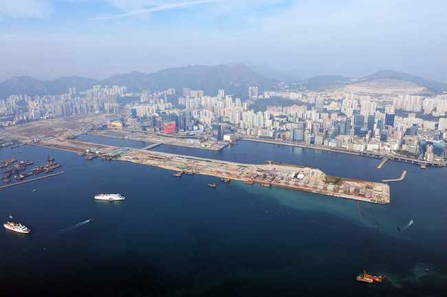 Aerial view of Kowloon East, former Kai Tak airport (foreground and left), Kowloon Bay (centre) and Kwun Tong district (right).