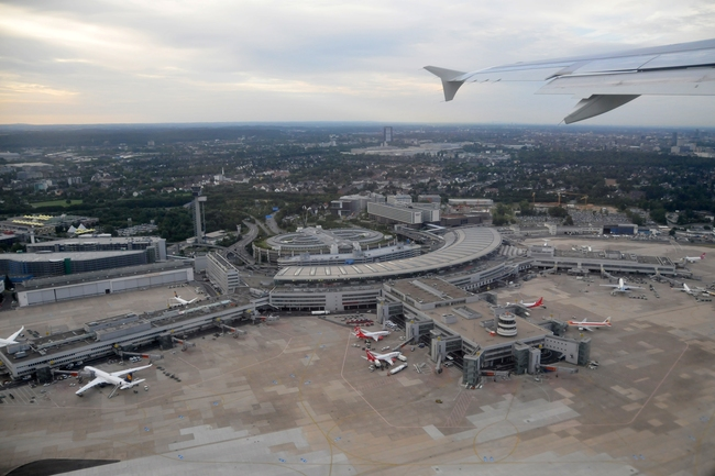 The Düsseldorf airport from above. The airport has been used to house refugees. Image via wikimedia.org