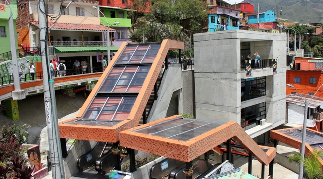 The escalators in Medellín's Comuna 13 have become a tourist attraction for international urbanists. Locals seem glad to have the visitors (Christopher Swope/Citiscope)