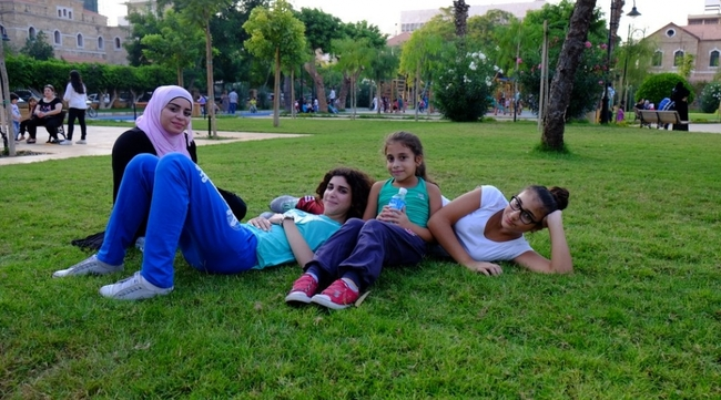 "Fifteen-year old Noura (second from left) lives near the newly restored Sanayeh Garden in Beirut and jogs here regularly. ""You can feel the air quality change as you enter the park,"" she says. (Photo: Reine Chahine, via citiscope.org)"
