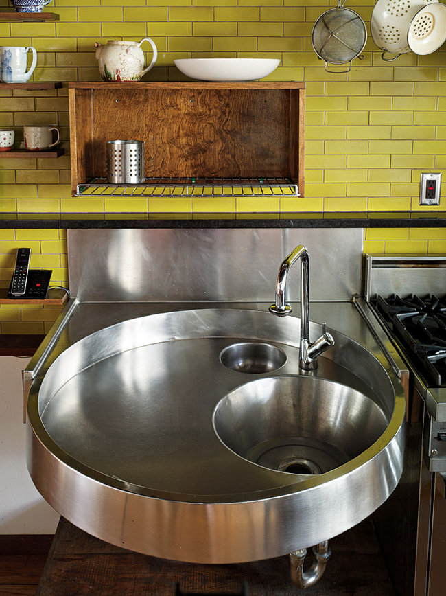 Her custom stainless steel kitchen sink, which is inset with a mixing bowl and bucket. Annie Schlechter