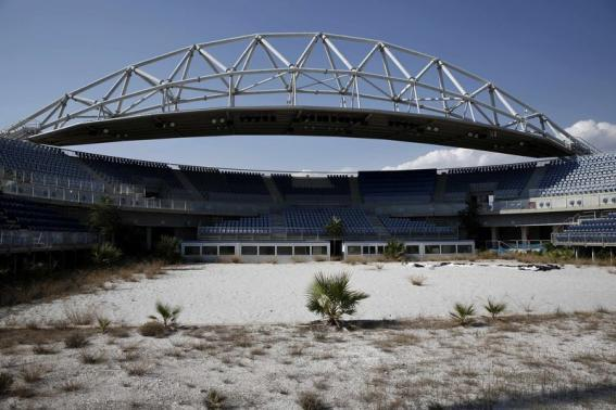 The abandoned stadium which hosted the beach volleyball competition during the Athens 2004 Olympic Games is seen at the Faliro complex south of Athens July 29, 2014. Credit: REUTERS/Yorgos Karahalis