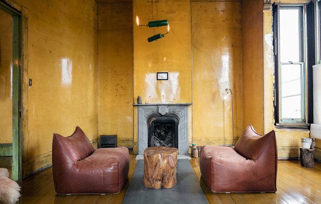 The back parlor of 500 Capp Street, with a sort of torch chandelier. Credit Henrik Kam, via 500 Capp Street Foundation