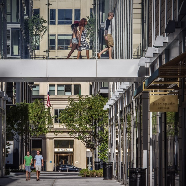 Pedestrians pass overhead and on street level near the new Kate Spade shop at CityCenterDC. (Bill O'Leary/Washington Post)