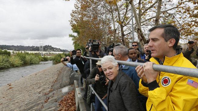 Mayor Garcetti and EPA Administrator Gina McCarthy tour the Los Angeles River last year. Garcetti plans to restore natural habitats along the river. (NPR; Photo: Damian Dovarganes/AP)