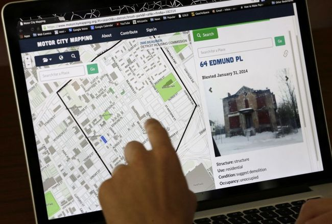 "Detroit residents can now use a ""blexting"" app — short for blight texting — to send photos about derelict properties to a mapping database in Detroit. (AP Photo/Carlos Osorio; via nextcity.org)"