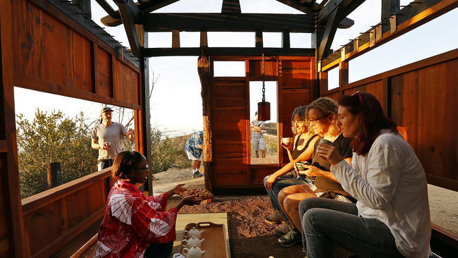 A teahouse built entirely of reclaimed, charred wood has been surreptitiously installed in Griffith Park overlooking Los Angeles. Credit: Al Seib/ Los Angeles Times