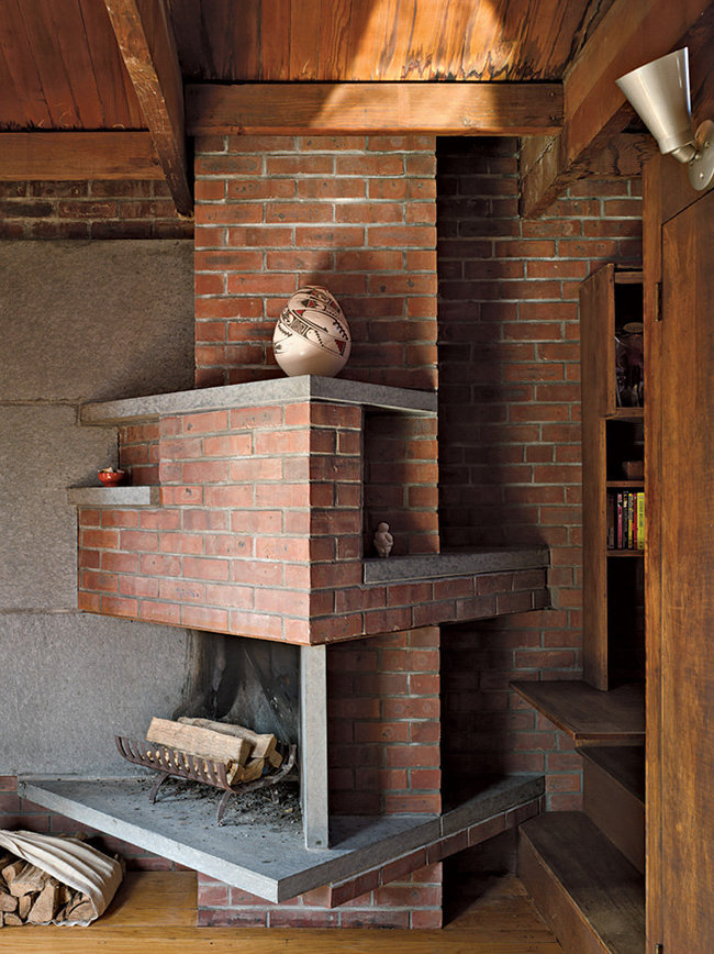 The third-floor sitting room's angular brick fireplace. Annie Schlechter