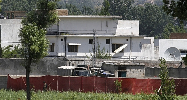 Anjum Naveed / AP A Pakistani soldier stands near a compound where it is believed al-Qaida leader Osama bin Laden lived in Abbottabad, Pakistan on Monday, May 2.