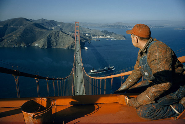 A painter on the Golden Gate Bridge. Photo by David Boyer, via education.nationalgeographic.com