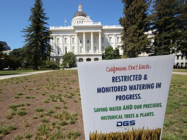 """Restricted & monitored watering in progress"" at the California State Capitol in Sacramento. (Image via roam and shoot/Flickr)"