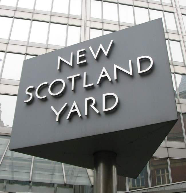The famous revolving sign outside the current New Scotland Yard, located in the Victoria area of London.