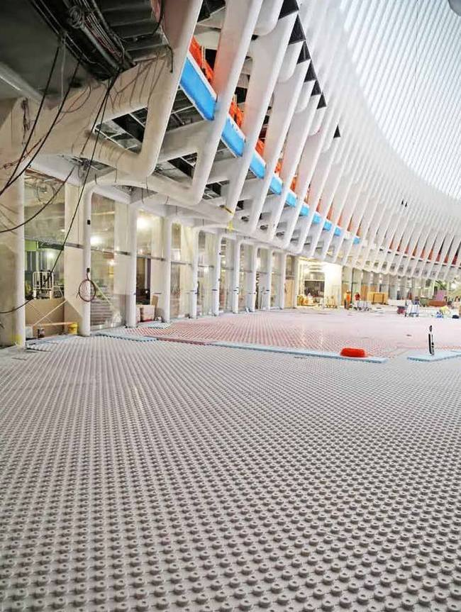 "Photo of the floor installation inside the World Trade Center Transportation Hub. (Image via ""WTC Progress"" Facebook page)"