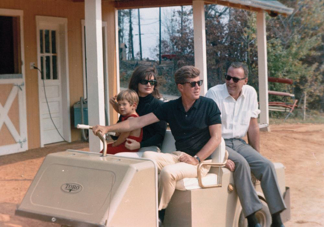 President John F. Kennedy in Golf Cart in Atoka, Virginia; courtesy: Cecil Stoughton/White House Photographs/ John F. Kennedy Presidential Library and Museum, Boston.