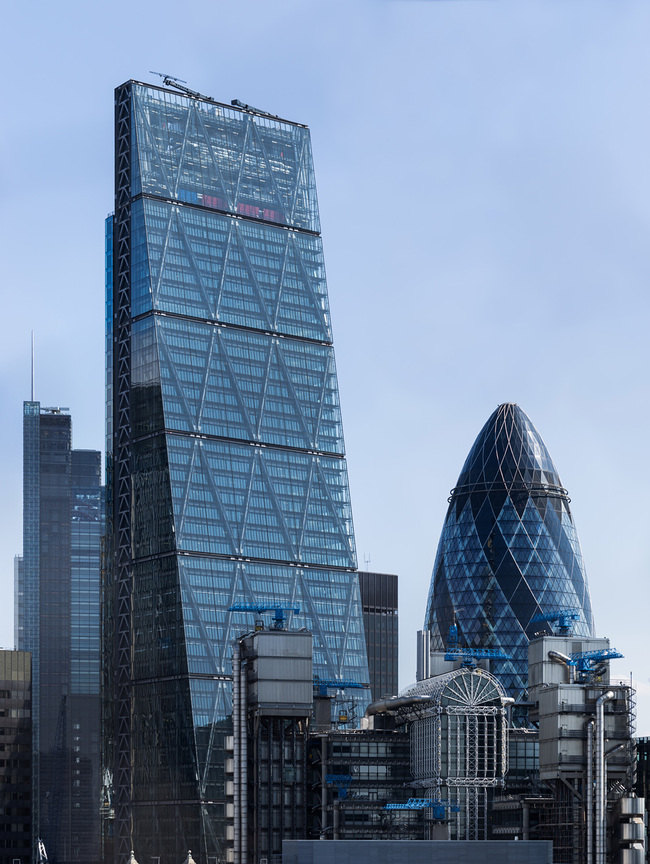 """The Cheesegrater"" tower (122 Leadenhall Street) and ""The Gherkin"" (30 St Mary Axe). Photo: Colin/Wikipedia"