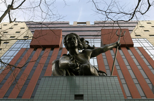 Portlandia statue outside of Michael Graves' Portland Building. Image via The Oregonian.