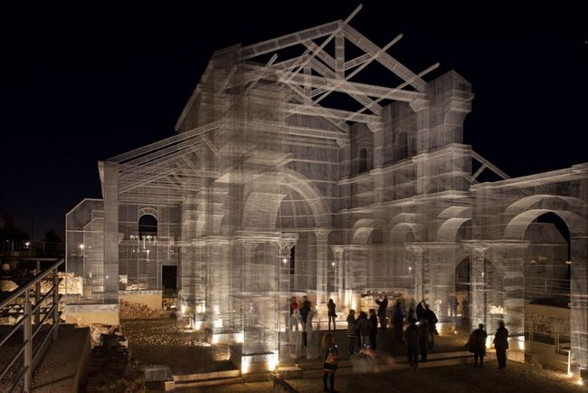 Edoardo Tresoldi's wire mesh sculpture of the Basilica di Siponto in Foggia, Italy. (Photo: Blind Eye Factory; Image via qz.com)