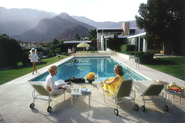 "Slim Aarons' ""Poolside Gossip"" photo, taken at the Kaufmann House (designed by Richard Neutra) in Palm Springs (1970). Image via theenglishroom.biz."
