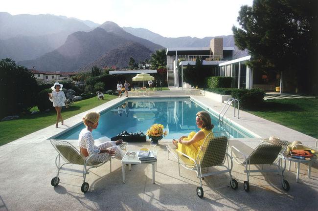 "Slim Aarons' ""Poolside Gossip"" photo, taken at the Kaufmann House (designed by Richard Neutra) in Palm Springs (1970). Image via theenglishroom.biz."