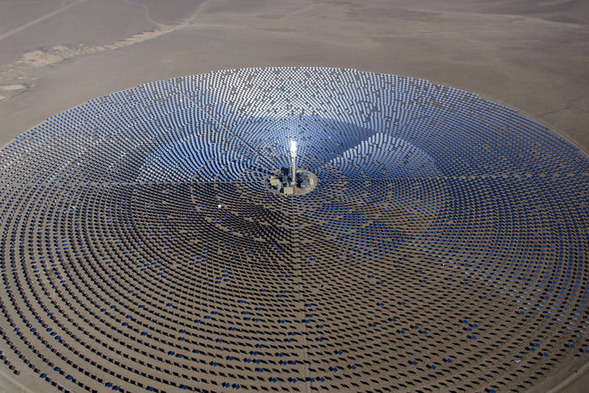 The new Crescent Dunes Solar Energy Plant in the Nevada desert uses molten salt and a giant solar farm to store the sun's heat and generate electricity for up to 10 hours after the sun has set. (Photo: SolarReserve; Image via npr.org)