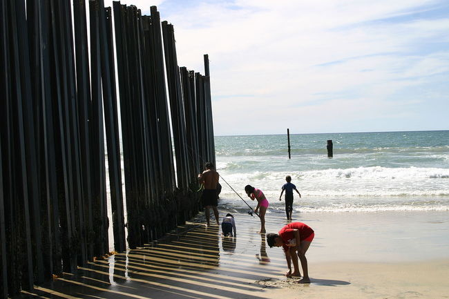The US-Mexico border fence in California. Image via wikimedia.org