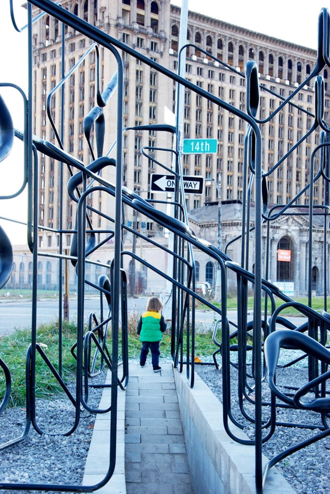 A toddler traverses the pavilion