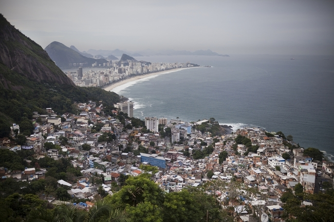Views of Ipanema Beach and the South Zone in Rio are seen from Vidigal. An eco-friendly hotel is under construction in the favela. The hotel, which will hire local workers, is part of a massive gentrification process underway in a neighborhood once wrought with violence and drug traffickers. (Lianne Milton for NPR)
