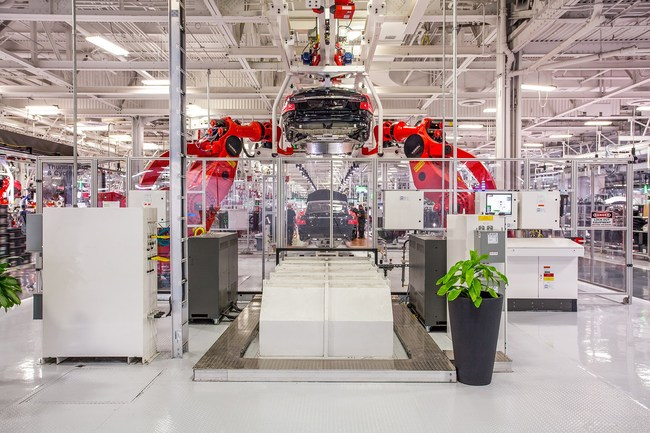 Where the robots have names: inside the Tesla Motos car plant in Fremont, California. (Photo: Tesla; Image via wired.co.uk)