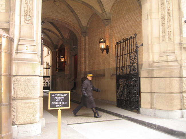 Doorman at the Dakota in NYC. Image via Wikipedia.