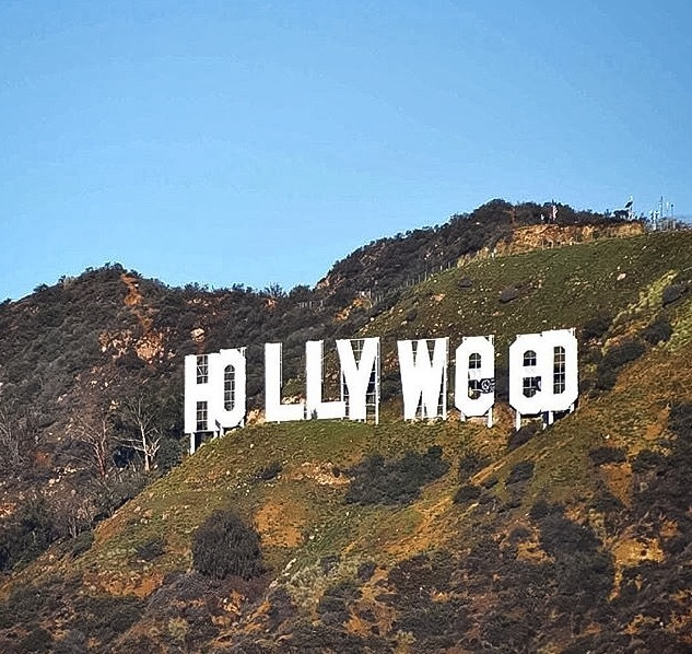 "For a few hours on New Year's Day 2017, the iconic Hollywood sign was briefly defaced with tarps to read ""Hollyweed."" Image: abc7la via Instagram"